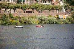 German and foreigner travelers people playing and paddle boat canoe and rest on garden Stock Photo