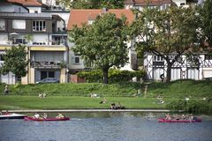 German and foreigner travelers people playing and paddle boat canoe and rest on garden Stock Photos