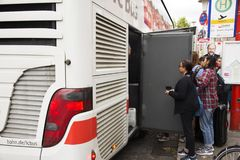 German and foreigner travelers people receive baggage from store room of bus. At Heidelberg bus station on August 31, 2017 in Heidelberg, Germany Royalty Free Stock Images