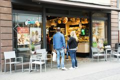 German and foreigner travelers standing and looking food at restaurant. In heidelberger market square or marktplatz on September 8, 2017 in Heidelberg, Germany Stock Photos