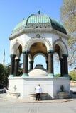 German Fountain in Istanbul. Turkish man taking water from German Fountain in Istanbul, Turkey stock photo