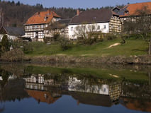 German framework houses. At a lake stock photo