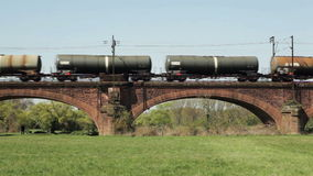 German freight train. Hochheim, Germany - April 20, 2015: A german freight train crosses a railway bridge between Mainz and Ginsheim one day before the beginning stock video