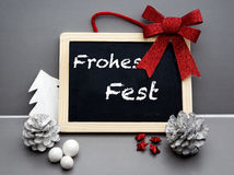 German 'Frohes Fest' (Merry Christmas) on blackboard Stock Images
