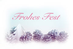 German 'Frohes Fest' (Merry Christmas) with pinecones Royalty Free Stock Photography