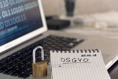 German General Data Protection Regulation DSGVO new law in 2018. Checklist, notepad on keyboard wth padlock, binary data on screen Royalty Free Stock Photo