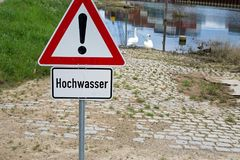 Flood sign. German general warning sign and additional sign with german text for flood Royalty Free Stock Images