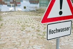 Flood sign. German general warning sign and additional sign with german text for flood Royalty Free Stock Photography