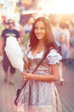 German Girl wearing a Dirndl and eating candyfloss Stock Photos