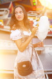 German Girl wearing a Dirndl and eating candyfloss Royalty Free Stock Photography