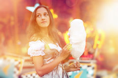 German Girl wearing a Dirndl and eating candyfloss Royalty Free Stock Photos