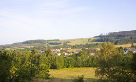 German green hills with little village Stock Photos