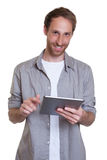 German guy working with tablet computer Royalty Free Stock Photography