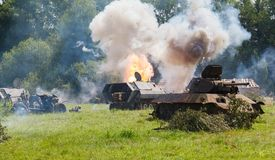 German half-track armored personnel. German medium half-track armored personnel on the field in the smoke and explosions of shells stock images