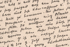 German Handwriting from 1924 - Detail. Detail of an handwritten German postcard from 1924 - black ink on yellowed paperboard royalty free stock photo