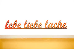 German handwritten phrase lebe liebe lache Stock Images