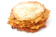 German hash browns. A heap of traditional fried delicious German hash browns. Image isolated on white studio background stock images