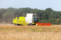 German havester works on a corn field Stock Photography