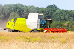 German havester works on a corn field Royalty Free Stock Images