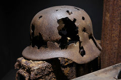 German helmet. A rusty German World War II military helmet Pierced with bullets, remnant of the Battle of the Bulge, found in the ardennes stock photos