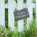 German: Herzlich Willkommen Stock Photo