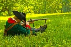 History German Revolutionary War at Reenactment. A German Hessian practicing shooting methods during a historical Revolutionary War Stock Images