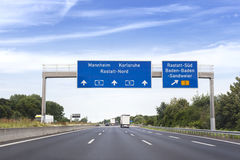 German highway. Road signs. Low-angle view Stock Photos