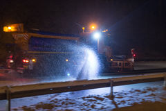 German highway snow plow at night Stock Photos