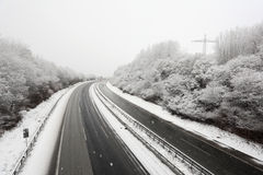 German highway during a snowstorm Stock Photo