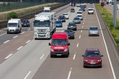 German highway traffic. FRANKFURT, GERMANY - JULY 11, 2013: Traffic on a German highway. German autobahns have no general speedlimit and rank as the fifth stock image