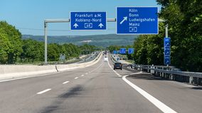 German highway with visible cars, signs and exits. Motorway without speed limit. German highway with visible cars, signs and exits. Motorway without speed limit royalty free stock photo