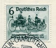 German historical stamp:  The first cars of Karl Benz and Gottlieb Daimler. `International auto and motor show in Berlin IAA 193. 9` special cancellation Berlin stock photo