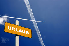 German holiday sign with jet trails Stock Images