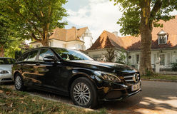 German houses and Mercedes-Benz luxury wagon car perked on germa. KEHL, GERMANY - JUL 14: 2016: Mercedes-Benz estate wagon car parked in center of typical German Stock Image