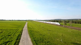 A German ICE highspeed railroad track. Wallau, Germany - April 07, 2017: A German ICE highspeed train passing by on the Frankfurt-Cologne line near Wallau stock video