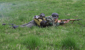 German infantryman lies in the grass. Reconstruction of the episode of the great Patriotic war Royalty Free Stock Photo