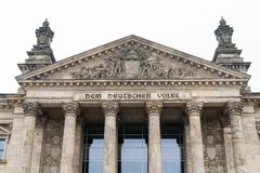 German inscription Dem Deutschen Volke, meaning To The German People, on the portal of Bundestag or Reichstag building. German inscription Dem Deutschen Volke Stock Images