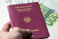 German international traveling passport and euro money. Royalty Free Stock Photography