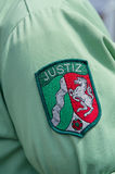 German Justice badge on a shirt s Stock Image