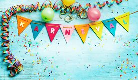 German karneval background with bunting flags. German karneval background with multicolored triangular bunting flags, streamers and party balloons forming a royalty free stock photography
