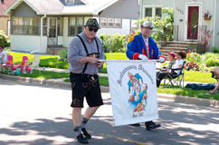 German Karneval Club Marchers. Two members of german karneval club or spielmannszug of minnesota march and hold banner in annual west st paul days grande parade royalty free stock photography
