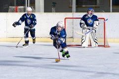 German kids playing ice hockey Stock Image