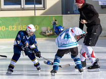 German kids playing ice hockey. Fuerstenfeldbruck, Bavaria, Germany - 06. February 2016: German Kids playing ice hockey. Age is about 10 years. Kick-off fight Stock Photos