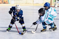 German kids playing ice hockey Stock Image