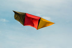 German kite flying in blue sky Royalty Free Stock Photography