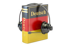 German language textbook with headset, learning and translate co Stock Photography
