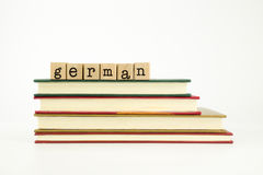 German language word on wood stamps and books Stock Photo