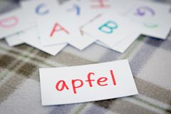 German; Learning the New Word with the Alphabet Cards; Writing A Stock Photos