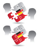 German lessons dialog. Two students and Puzzle bubble talk with a German flag symbolizing German conversation.Vector illustration Stock Photos