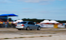 German luxury car. Luxury german car at motion with blurred background stock photography